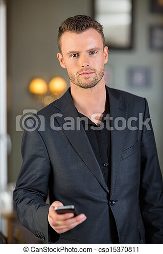 Businessman With Cellphone In Coffeeshop - csp15370811