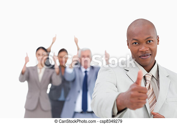 Businessman with cheering team behind him giving approval - csp8349279