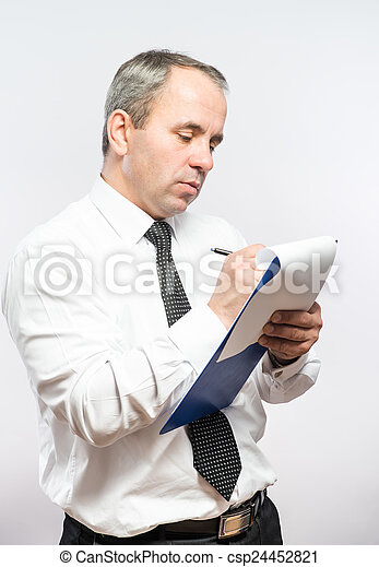 Businessman  with clipboard in his hand - csp24452821