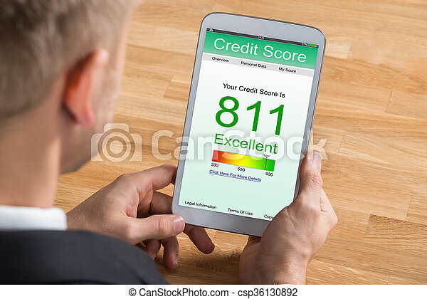 Businessman With Digital Tablet Showing Credit Score - csp36130892
