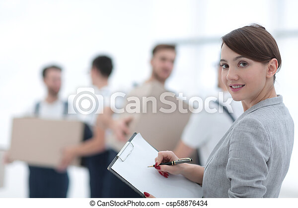 Businessman with documents, creating a stack of cardboard boxes. - csp58876434