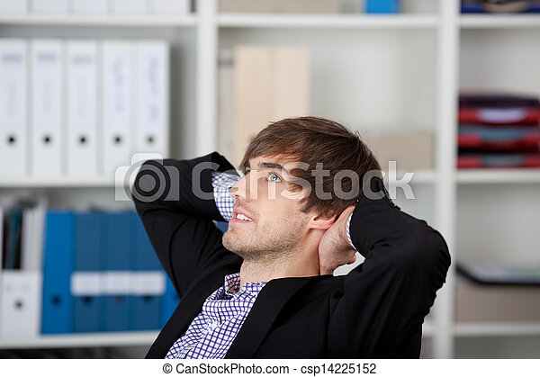 Businessman With Hands Behind Head Looking Up In Office - csp14225152