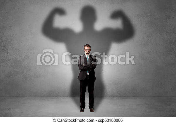 Businessman with muscular shade behind his back - csp58188006