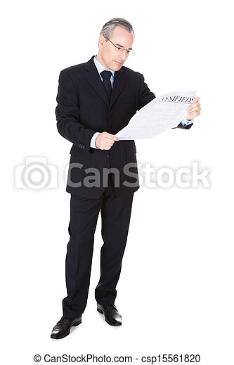 Businessman With Newspaper - csp15561820
