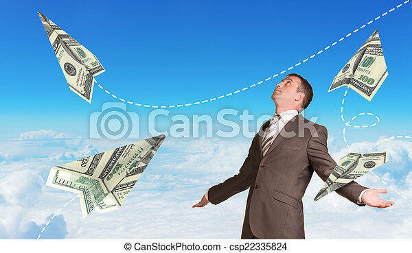 Businessman with paper airplanes made of hundred dollar bills - csp22335824