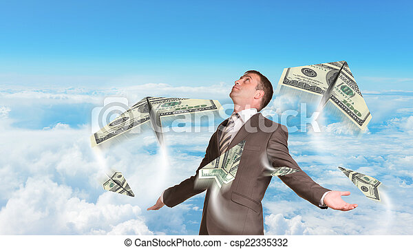 Businessman with paper airplanes made of hundred dollar bills - csp22335332