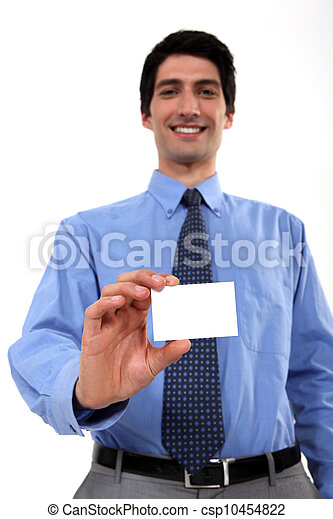 businessman with toothy smile showing business card - csp10454822