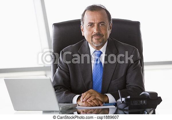 Businessman working at desk - csp1889607