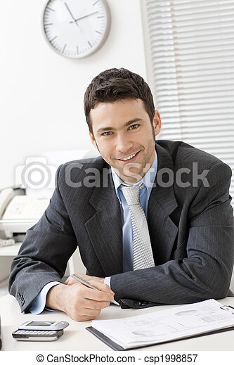 Businessman working at desk - csp1998857