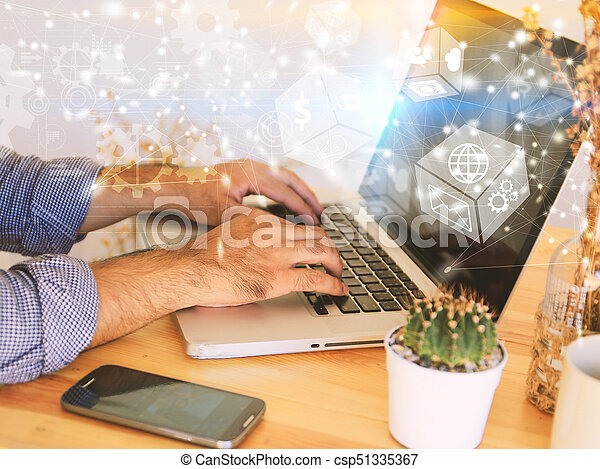 Businessman working at office desk using laptop. - csp51335367