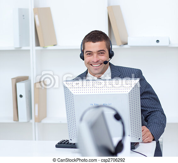 Businessman working in a call center - csp2706292