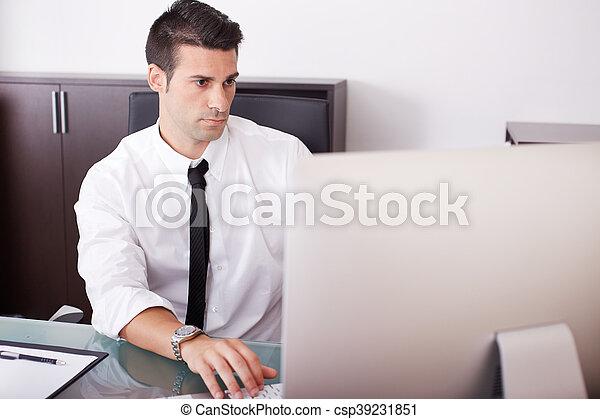 businessman working in office - csp39231851