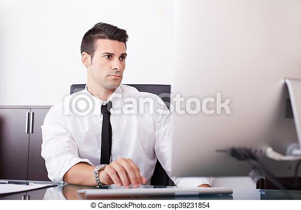 businessman working in office - csp39231854