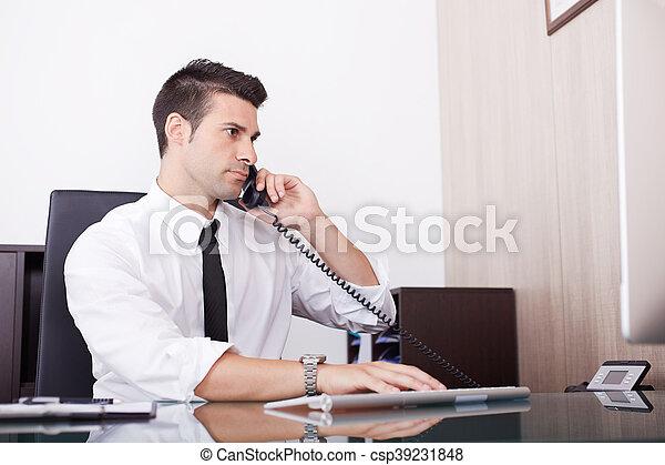 businessman working in office - csp39231848