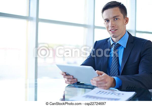 Businessman working in office - csp22724697