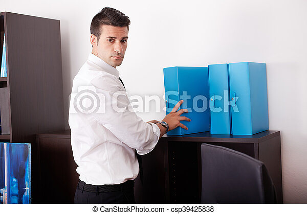 businessman working in office - csp39425838