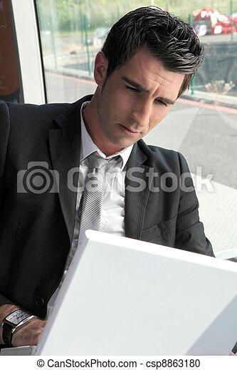 Businessman working on computer - csp8863180