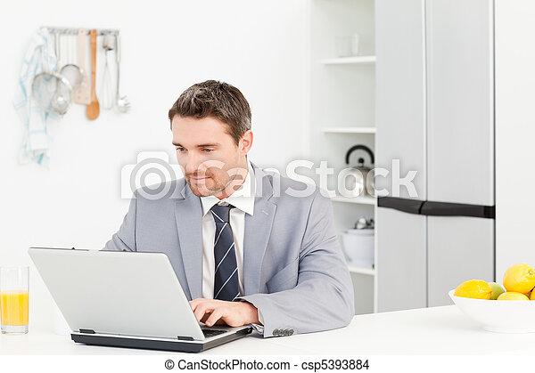 Businessman working on his laptop - csp5393884