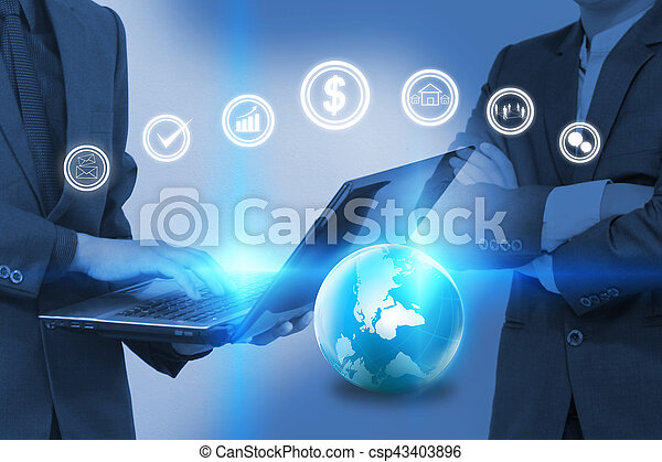 Businessman working on laptop with business icons. - csp43403896