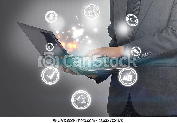 Businessman working with laptop. - csp32782878