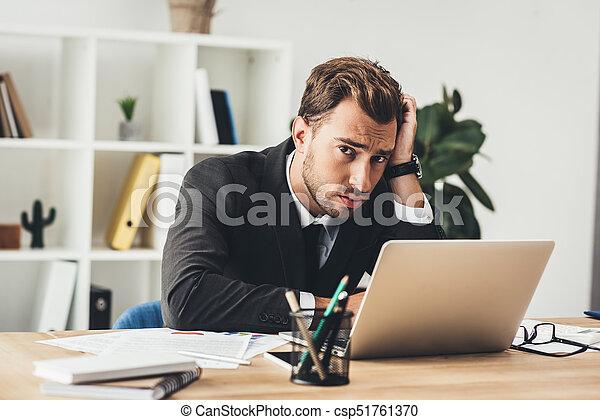 businessman working with laptop - csp51761370