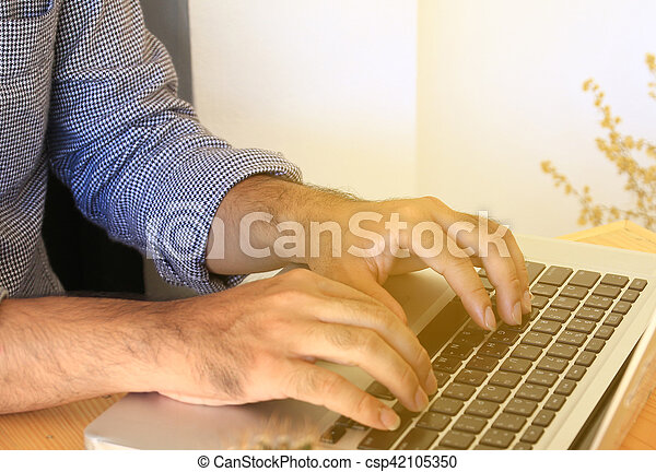 Businessman working with laptop. - csp42105350