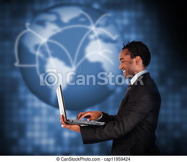 Businessman working with laptop - csp11959424