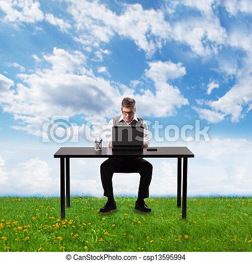 Businessman working with laptop. - csp13595994