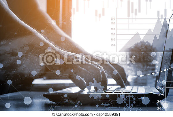 Businessman working with laptop. workplace,financial paperwork and reports, graph, planning - csp42589391