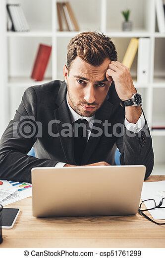 businessman working with laptop - csp51761299
