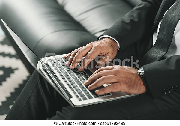 businessman working with laptop - csp51792499