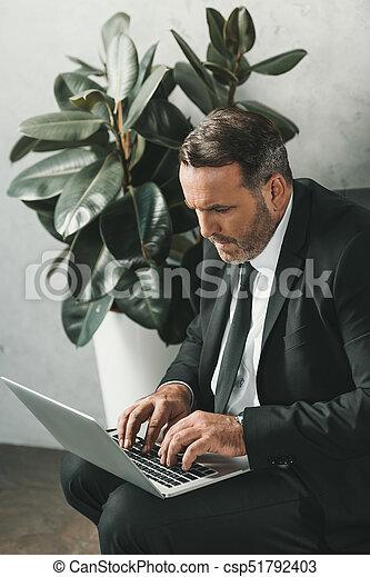 businessman working with laptop - csp51792403