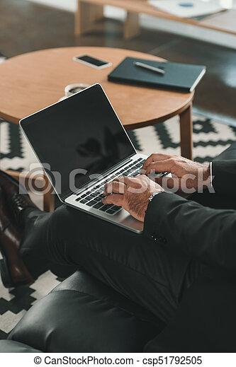 businessman working with laptop - csp51792505