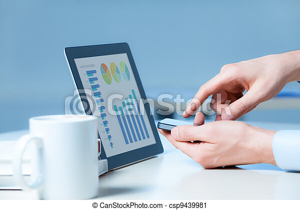 Businessman Working With Modern Devices - csp9439981