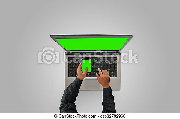 Businessman working with smartphone and laptop,green screen - csp32782966