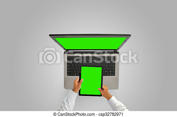 Businessman working with tablet and laptop,green screen - csp32782971