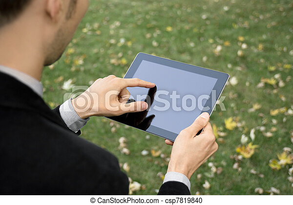 Businessman Working With Tablet PC - csp7819840