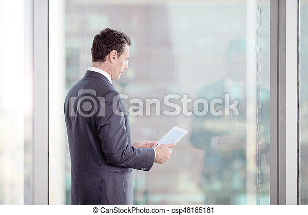 Businessman working with tablet - csp48185181