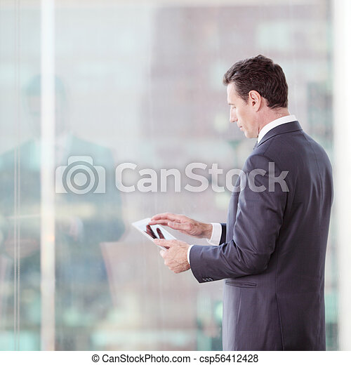 Businessman working with tablet - csp56412428