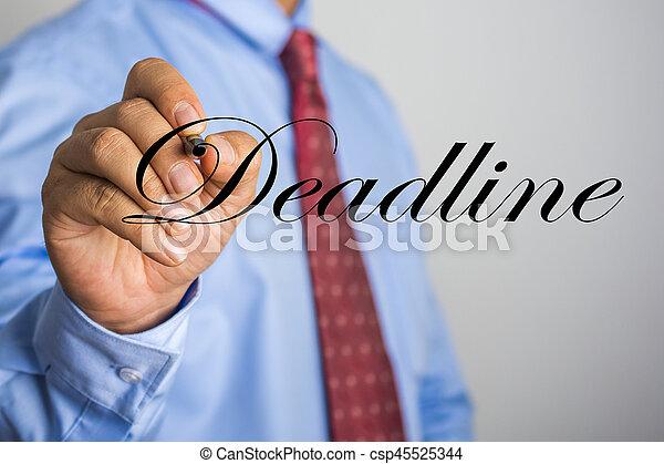 Businessman writing Deadline word on virtual screen - csp45525344