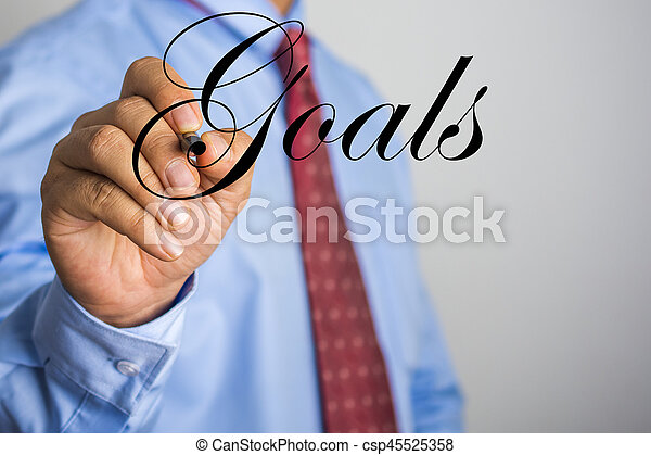 Businessman writing Goals word on virtual screen - csp45525358