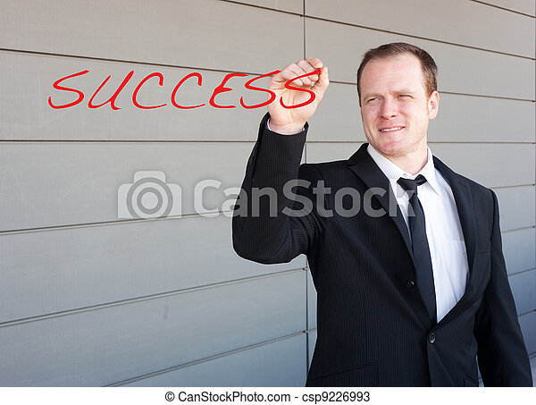 businessman writing the word success on screen - csp9226993