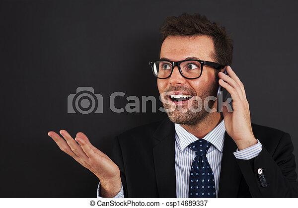 Businessmen discussing on mobile phone - csp14689337