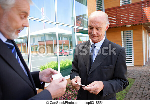 Businessmen exchanging business cards - csp8318554