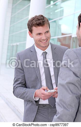 Businessmen exchanging phone numbers - csp9977397