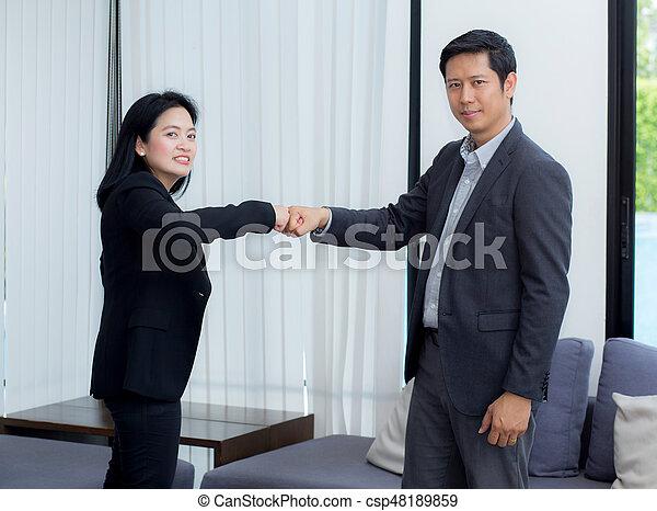 businessmen giving fist bump after business achievement in meeting room - teamwork concept. - csp48189859