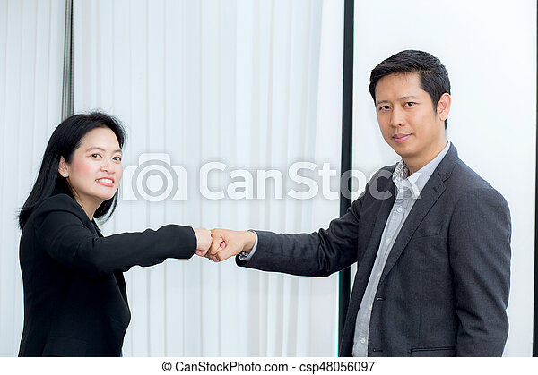 businessmen giving fist bump after business achievement in meeting room - teamwork concept. - csp48056097
