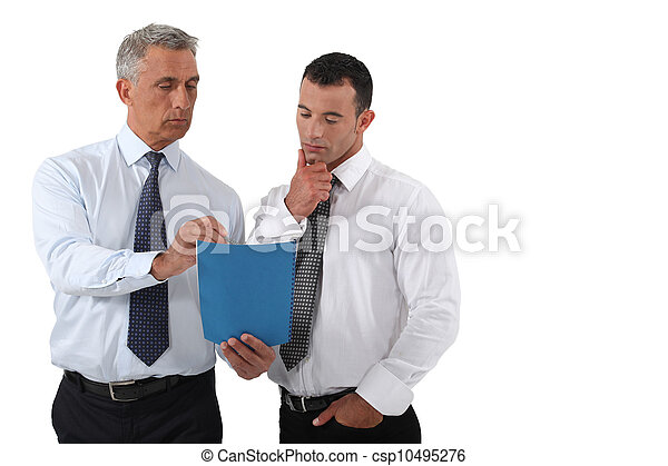 businessmen looking at a report - csp10495276