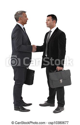 Businessmen shaking hands - csp10380677
