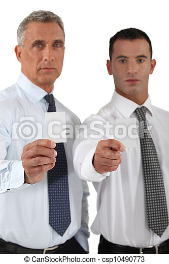 Businessmen showing blank business cards - csp10490773